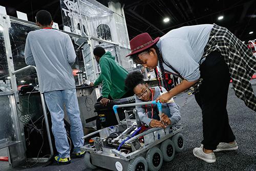 FIRST girls working on robot
